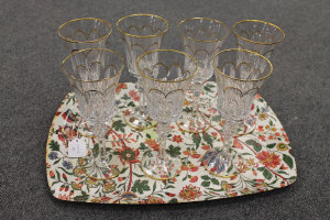 A set of eight Faberge gilded crystal wine glasses, height 23 cm. (8)