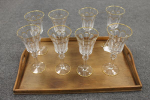 A set of seven Faberge gilded crystal wine glasses, height 22 cm. (8)