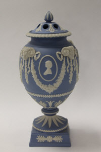 A Wedgwood Royal Wedding urn and cover, in blue and white jasper ware, height 30 cm, boxed.