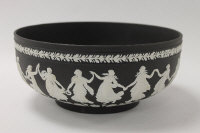 A Wedgwood bowl, in black and white jasper ware, diameter 26 cm, boxed.