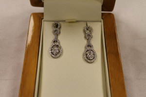 A pair of 18ct  white gold diamond drop earrings. (2)