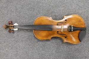 A late nineteenth century Scottish school violin, labelled within by John Tweedy, full size with bow in coffin case.
