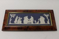 A Wedgwood plaque depicting The Offering To Flora, in blue and white jasper ware, width 39 cm, framed, boxed.