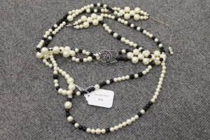 A Chanel two-tone beaded necklace.