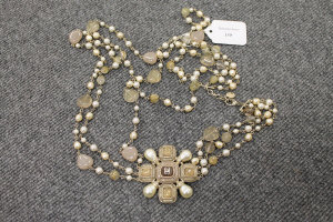A Chanel three stranded necklace set with faux gemstones.