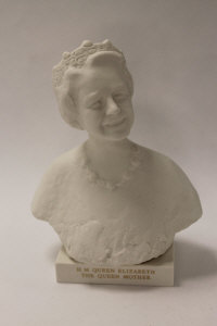 A Wedgwood figure - The Queen Mother, in white parian, height 23 cm, boxed.