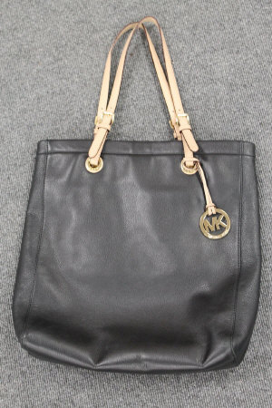 A Michael Kors black leather tote bag.