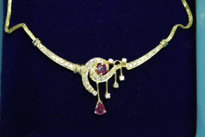 A 22ct gold ruby and diamond necklace.
