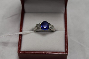 An 18ct white gold two stone diamond and sapphire ring.