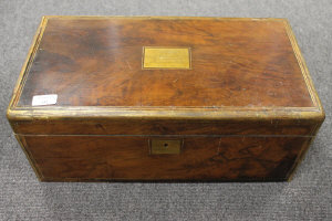 A nineteenth century brass mounted mahogany writing box, with inscribed panel dated 1880, width 50 cm.
