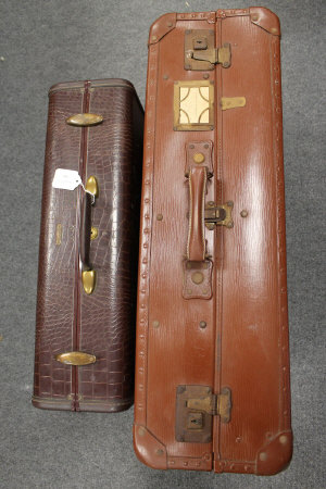 A vintage Samsonite suit case, together with an early twentieth century French fitted suitcase. (2)