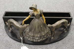 A French Art Deco desk stand with patinated spelter figure of a lady and two lurchers,  width 43.5 cm.