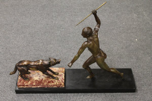 An Art Deco bronze figure of a man and wolf, on marble plinth, signed Brault, width 70 cm.