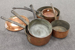 Seven French copper pans and a copper plate. (8)