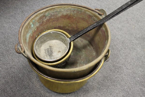 Two vintage long handled pans, together with two large brass jam pans. (4)