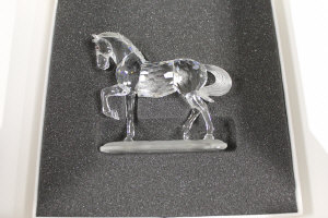 A Swarovski silver crystal figure - Horse with foot raised, boxed.