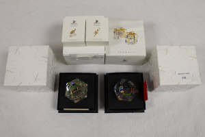 Two Swarovski crystal Arribas collection paperweights, together with three Crystal Memories accessories and alarm clock with teddy bear, all parts boxed. (6)