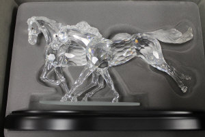 A Swarovski Silver Crystal limited edition figure - The Wild Horses, numbered 3288/10000, on plinth with framed certification, inspection gloves and reinforced carry case.