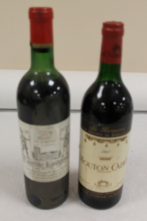 Ten bottles of red wine - 1967 Mouton Cadet, 1972 Chateau Lagrange and others. (11)