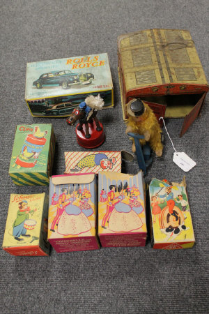 A Mettoy tin plated Joy Town Fire Brigade station, together with a collection of nine mechanical and other toys, part boxed. (10)