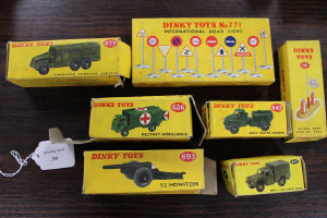 A Dinky Toys No.771 International Road Sign set, together with Petrol pump 781 and five military vehicles, all parts boxed. (7)