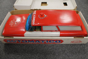 A Pico tin plated battery operated fire service vehicle, 'bump n' go' action, boxed.