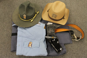 An original Georgia State patrol uniform, with two hats and holster.