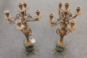 A pair of ornate spelter and marble four-way candelabra, height 60 cm. (2)