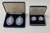 A pair of Wedgwood silver dressing table pots with blue jasper ware tops depicting Prince Charles and Diana Princess of Wales, together with a pair of medallions of the same subject, all boxed. (2)