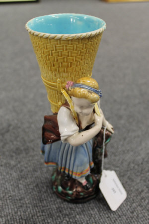 A Minton figure of a lady holding a basket, height 23 cm.