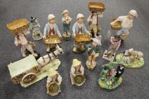 A collection of fourteen Staffordshire and other pottery figures depicting farm workers etc. (14)