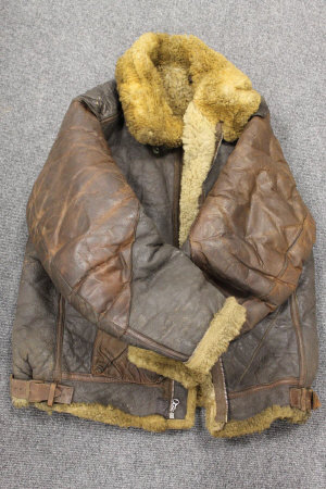 An early twentieth century military issue brown leather and sheep skin bomber jacket.