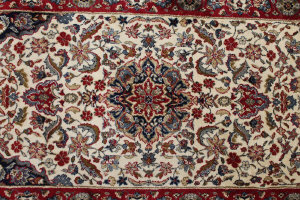 A Kashmir fringed carpet runner on cream and red ground, 235 cm x 68 cm.