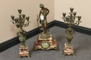 A three piece marble and spelter clock set in Art nouveau style. (3)