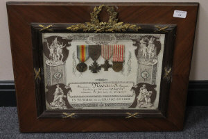 A montage of four WW I French medals, framed.