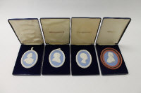 A Wedgwood plaque depicting George Stubbs, in blue jasper ware, width 8.5 cm, together with three other limited edition plaques, all boxed. (4)
