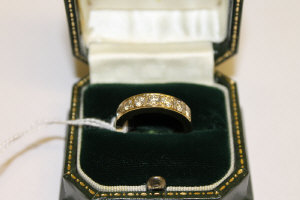 An 18ct gold diamond seven stone eternity ring, approximately 1ct.