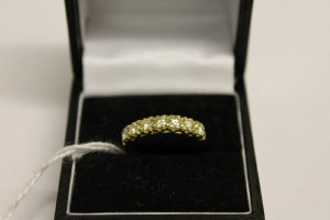 An 18ct gold seven stone diamond ring, approximately 0.85ct.