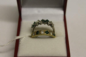 Two 18ct gold diamond and emerald rings. (2)