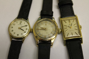 A 9ct gold Omega lady's wrist watch, together with two other watches by the same manufacture.  (3)