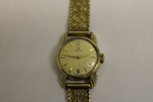 A 9ct gold Omega lady's wrist watch.