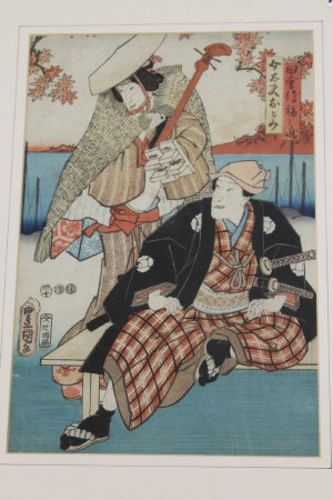 Nineteenth century Japanese School : A warrior being serenaded at the water's edge, woodcut in colours, 35 cm x 23 cm, script showing verso, framed.