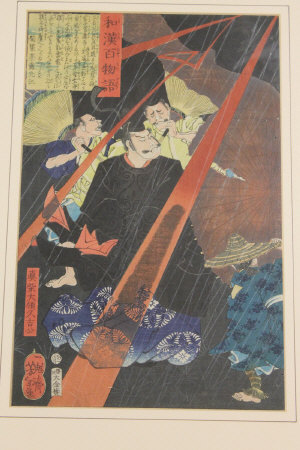 Nineteenth century Japanese School : Three men sheltering from a storm, woodcut in colours, 34 cm x 22 cm, showing script verso, framed.