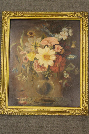 Manner of Edward Ladell : A still life with mixed flowers in a vase, oil on panel, 35 cm x 28 cm, framed.