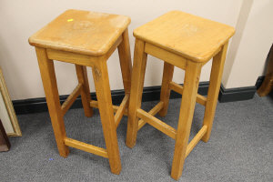 A pair of 'Seahorse Man' pine stools, height 70 cm. (2)