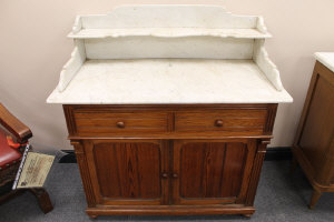 A Victorian marble topped pitch pine wash stand, width 111 cm.