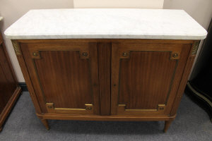 An early twentieth century two drawer mahogany side cabinet with marble top, width 111 cm.