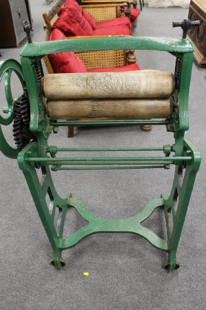 A Victorian mangle painted in green, height 116 cm.