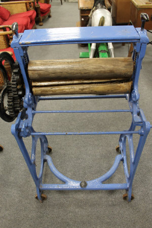 A Victorian mangle painted in blue, height 115 cm.