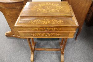 A nineteenth century inlaid rosewood sewing table, on round legs with understretcher, width 51.5 cm.